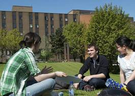 Institution featured at 70 percent quality 1003 students sit campus lawn building in backdrop uni strathclyde20120906 2 11ip57l